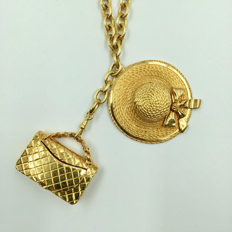 Chanel Gold Tone Classic Coco Chanel Chapeau and Quilted Handbag Charm Necklace