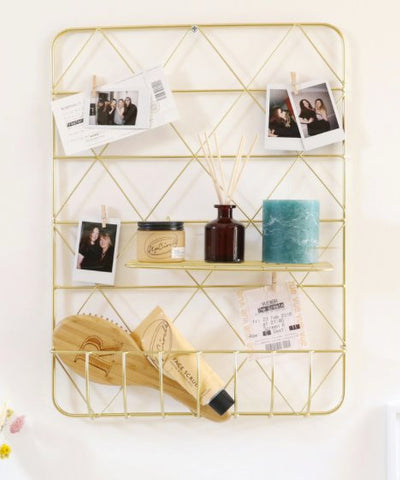 gold metal display shelf