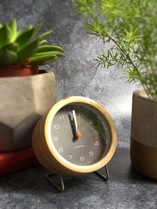 grey and wood alarm clock