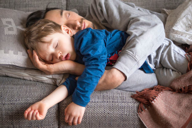 boy and dad sleeping