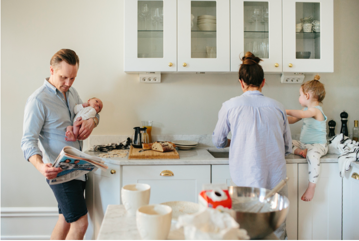 mom and dad in kitchen with kids