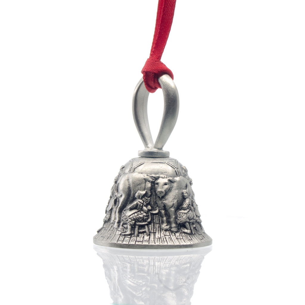 Eight Maids A-Milking Christmas Bell. Made from Pewter. Red Ribbon. Made in Fredericton New Brunswick NB.