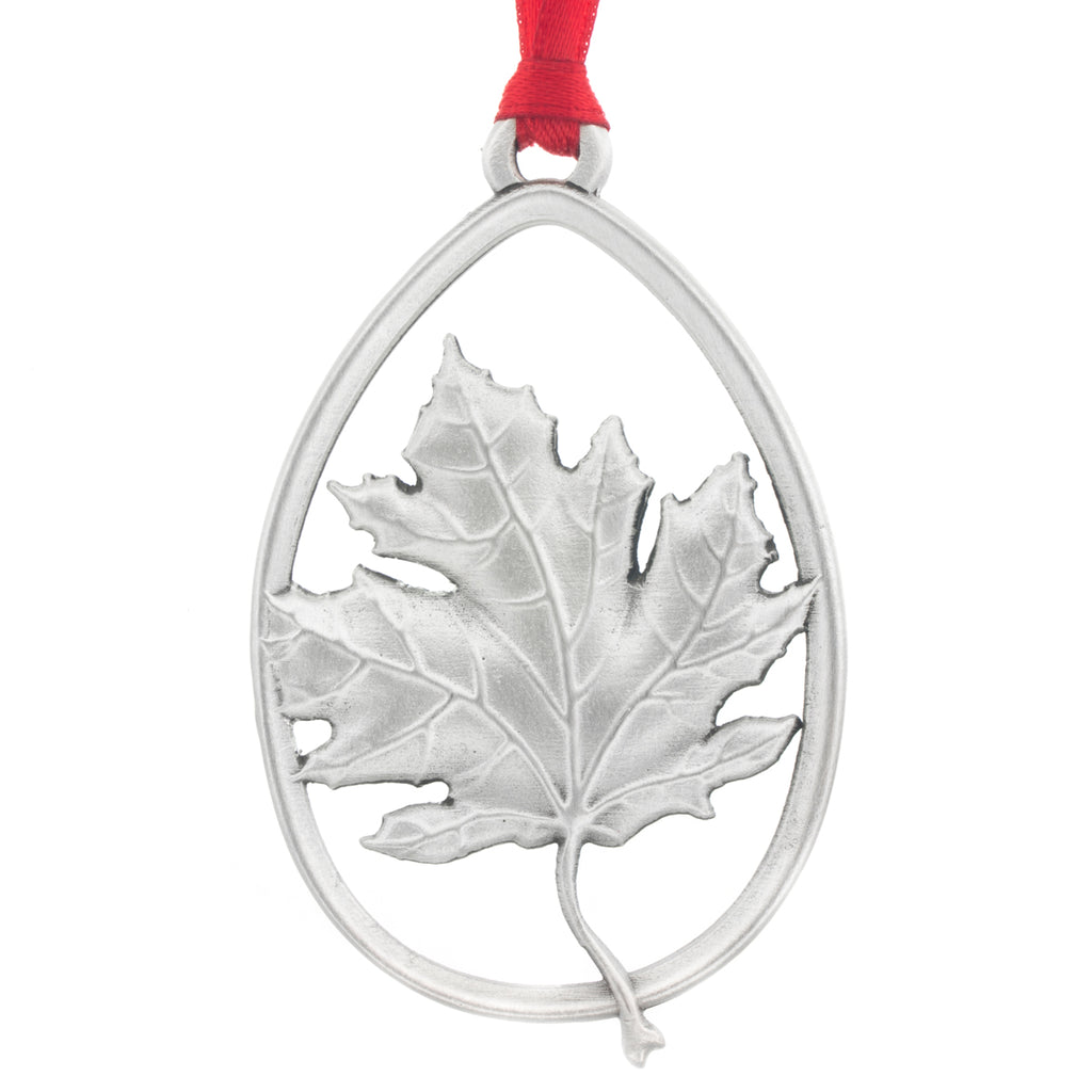 Canadiana. Maple Leaf. Canadian. Christmas Tree ornament. Made from Pewter. Red ribbon. Made in Fredericton NB New Brunswick Canada