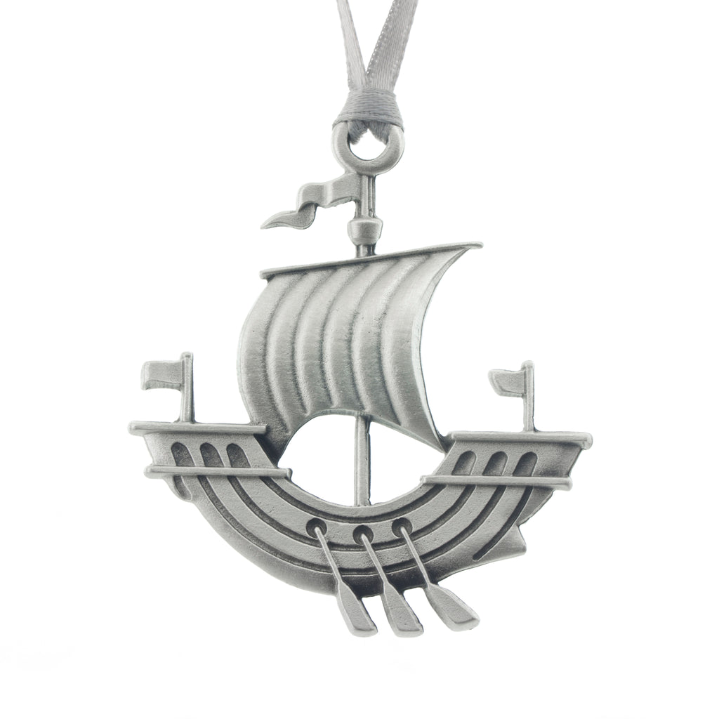A NB Galley with oars. Just like the one on the NB Flag. Christmas Tree ornament. Made from Pewter. Silver ribbon. Made in Fredericton New Brunswick Canada