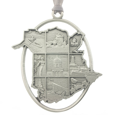 The province of New Brunswick in silhouette, inset with a grid of NB scenes. Christmas Tree ornament. Made from Pewter. Silver ribbon. Made in Fredericton NB Canada