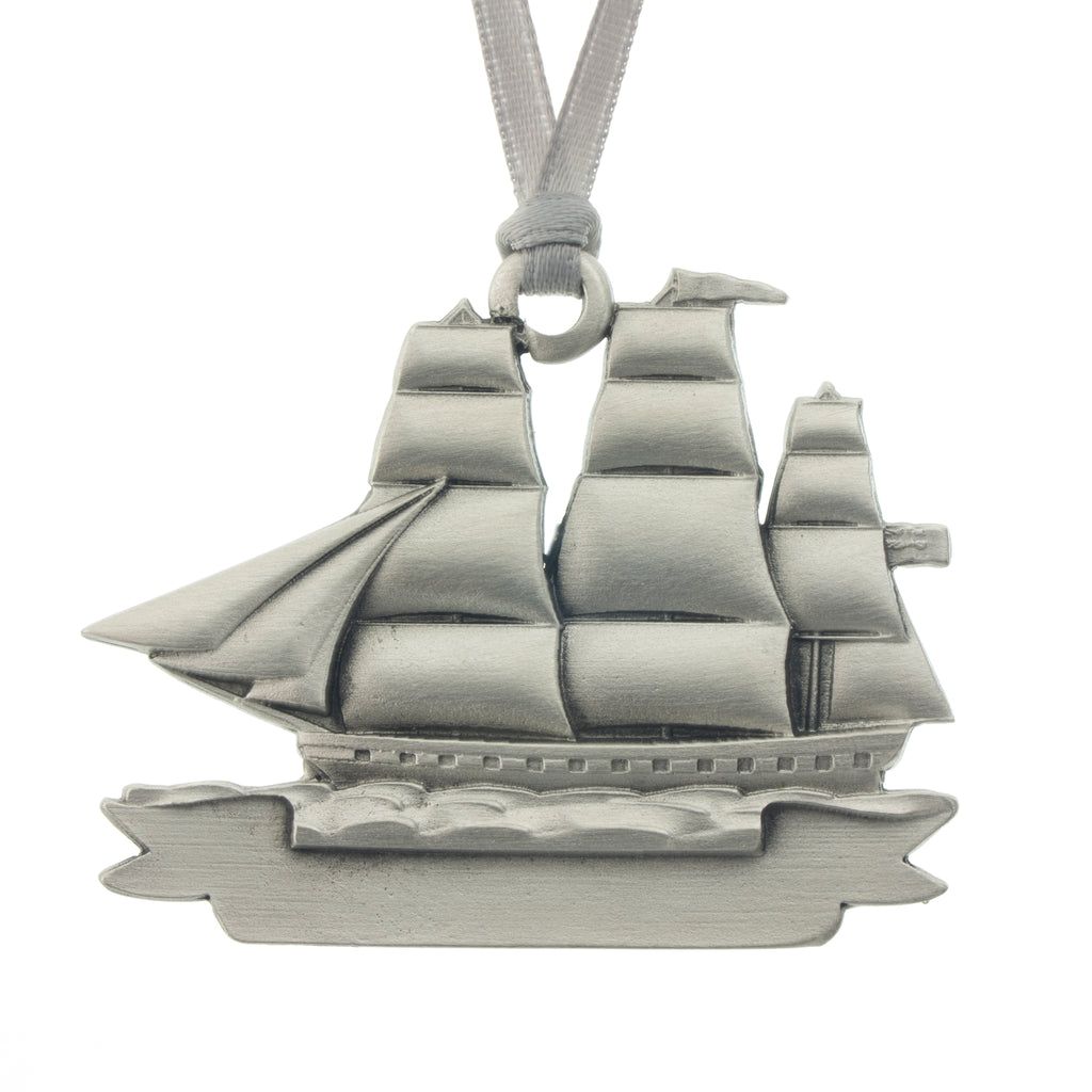 An adventurous tall masted clipper ship with full sails. Christmas Tree ornament. Made from Pewter. Silver ribbon. Made in Fredericton NB New Brunswick Canada