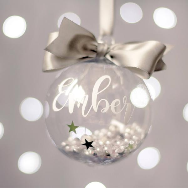 personalised christmas bauble for the family name and year filled with sparkly things beads white silver xmas decoration