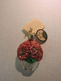 Poinsettia Ornament by Inge Glas