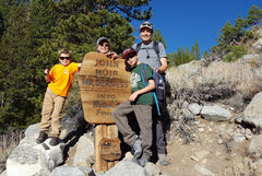 Brad Baker, Owner and President of Excel Math, hiking with his wife and grandsons