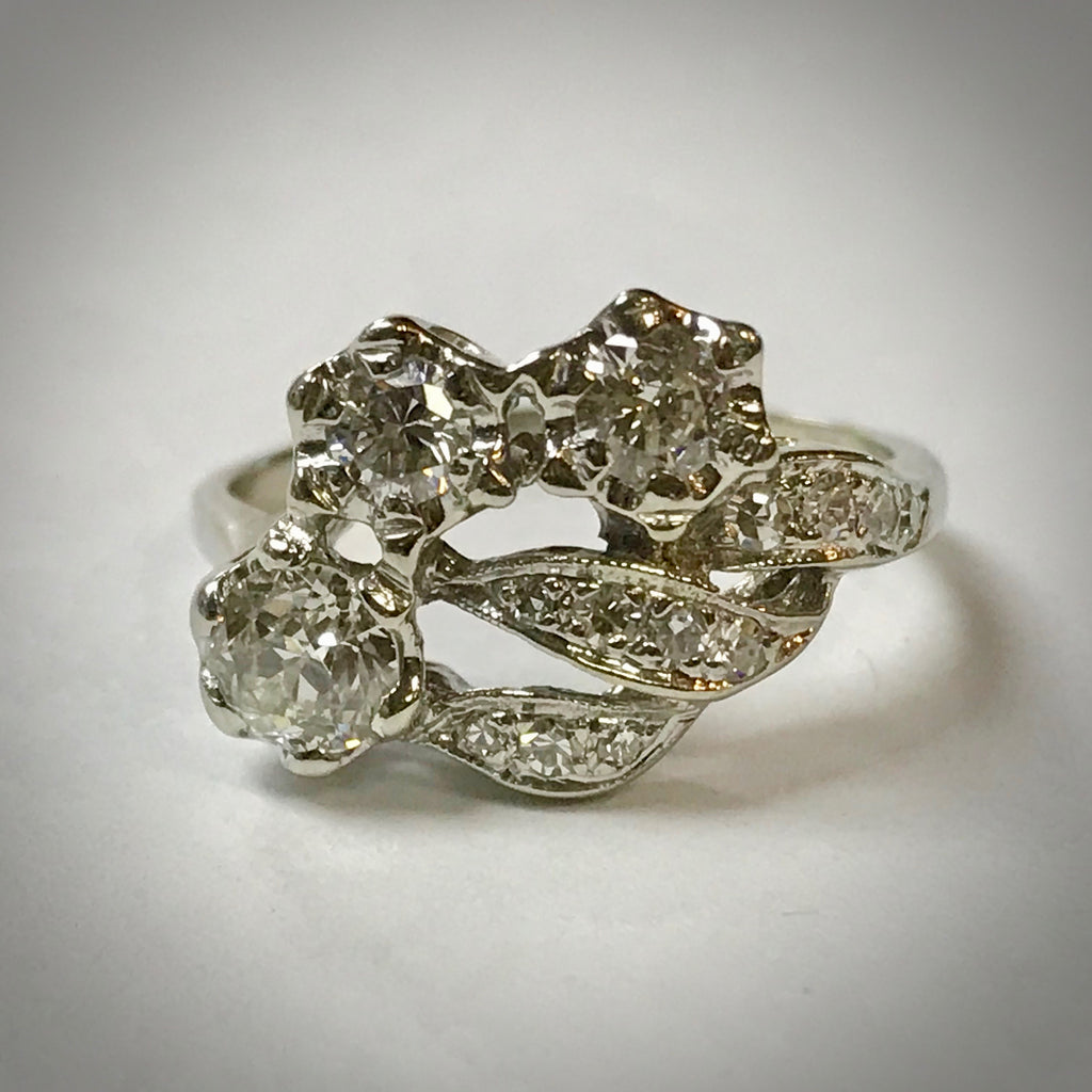 Ladies 14WK vintage .80 ctdw ring with flower and foliate motf