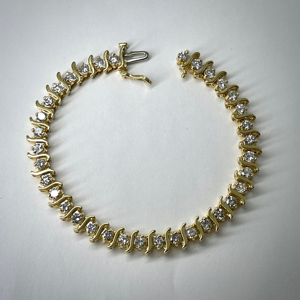 "Lady's 18KY ""S"" link bracelet 5.0 carat total diamond weight"