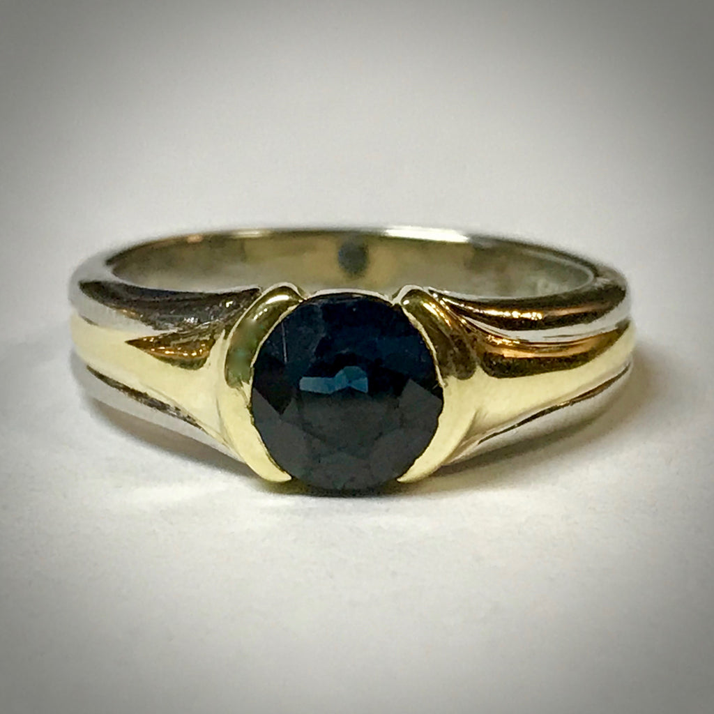 Ladies Platinum & 18KY ring with a 1-1/2ct round blue sapphire