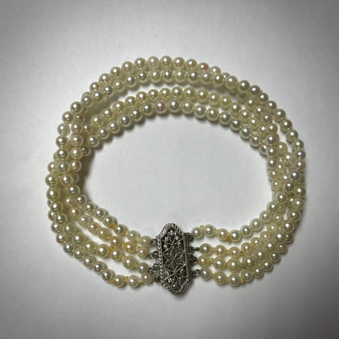 "Ladies 6-1/2"" 14KW four strand 3-3.5mm cultured pearl bracelet"