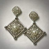 Ladies 18KW cultured pearl and 1ctdw earrings