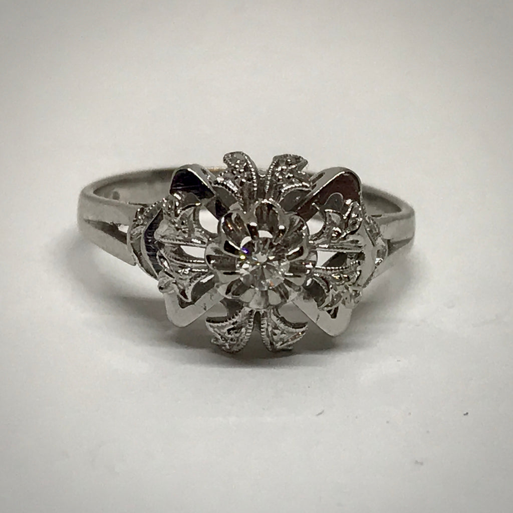 Ladies 18KW vintage ring .07 carat round brilliant cut diamond