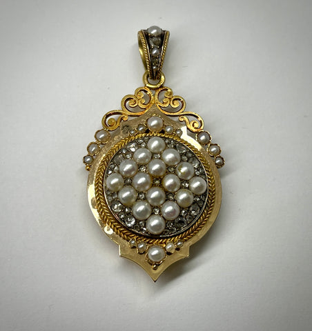 Lady's anitique 18KY locket with pearls and rose cut diamonds