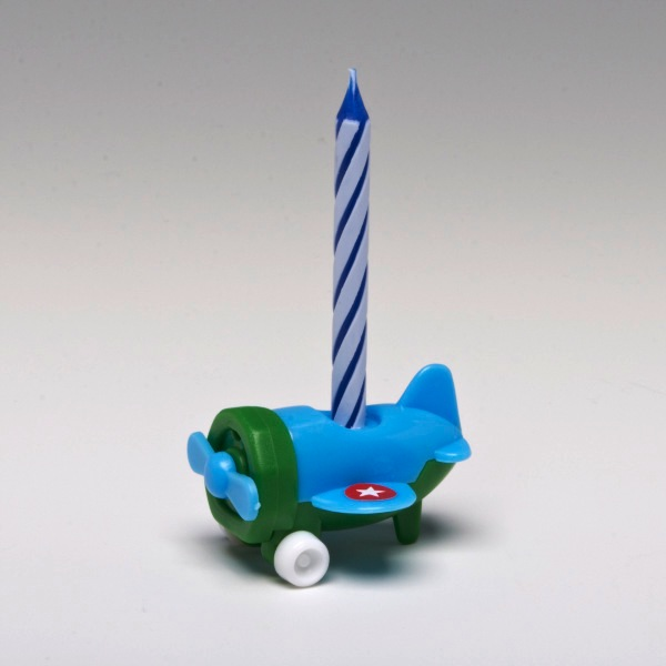 Four Birthday Candles In Decorative Airplane Shaped Colored Holders