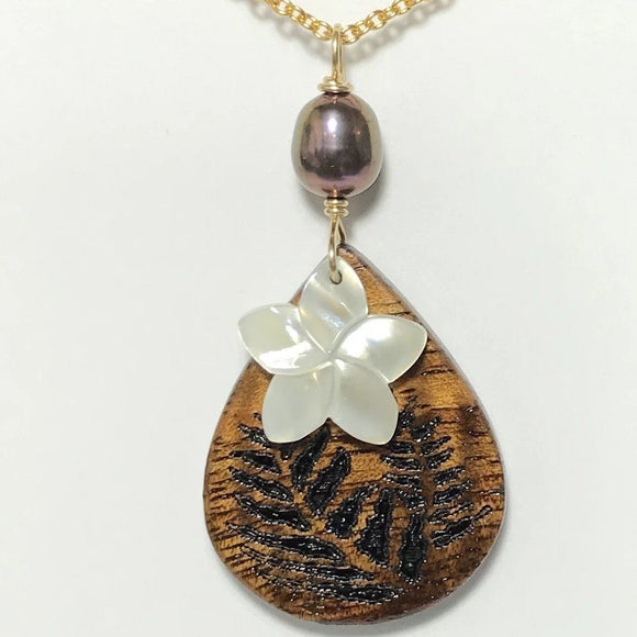 Koa Wood Teardrop Shaped Fern Engraved Pendant with Plumeria Carved Shell Pendant and Peacock Purple Pearl Necklace