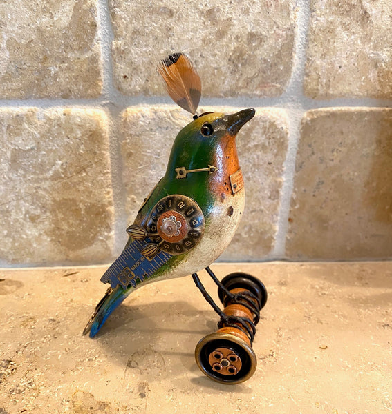 Bird on Wheels with Feather