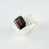 double ruffle ring with Mozambique garnet