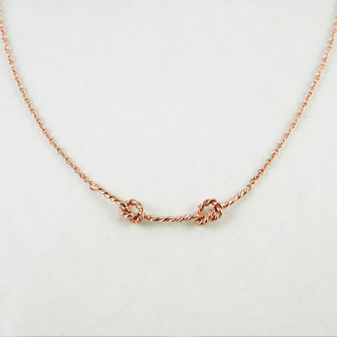Double love knot pendant, 14kt rose gold