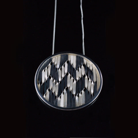 herringbone pendant, oxidized and bright silver