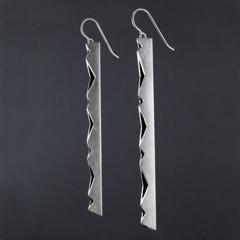 long vertical linear earrings with cut out