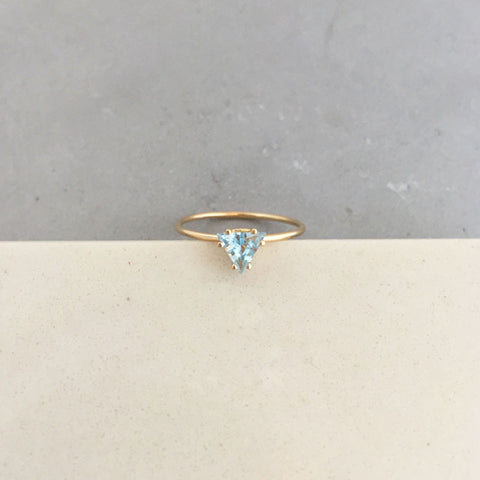 Bermuda triangle blue topaz ring