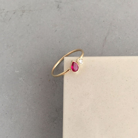 pear birthstone ring with accent diamond