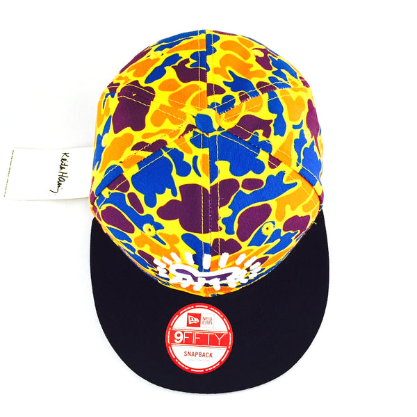 Keith Haring Baby Yellow Camo New Era 9Fifty Snapback Cap – urban TEE dc61ba8ac02