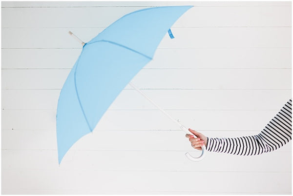meet Rosie, owner and founder of BrollyBucket umbrella hire service - bride behind the umbrellas