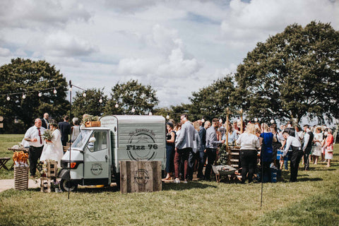 White Big Day Wedding Umbrella package sitting next to the Prosecco Van and Wedding Food  Truck at Abbi and Ash Rock my Wedding featured festival wedding