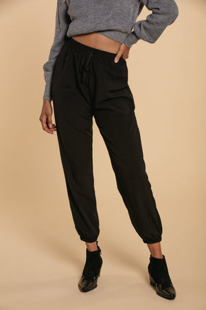 Black trousers with elastics