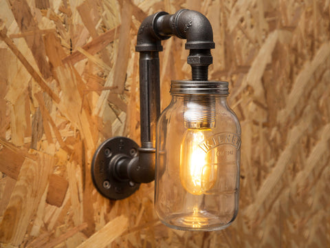 black industrial iron pipe wall light with kilner jar