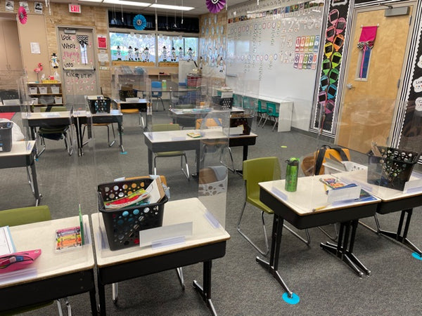 Clear sneeze guard barrier in classroom setting