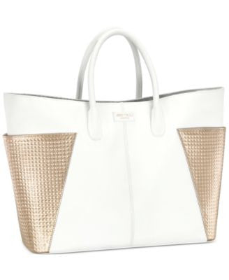 Receive a Complimentary Tote with any large spray purchase from the Jimmy Choo Women's fragrance col