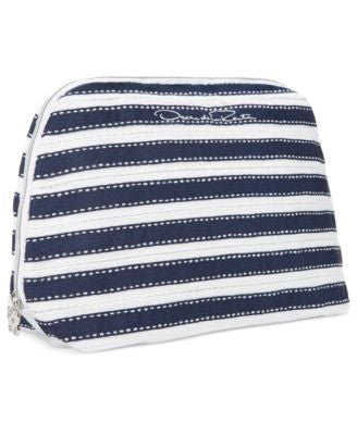 Receive a FREE Pouch with any $85 Oscar de la Renta purchase