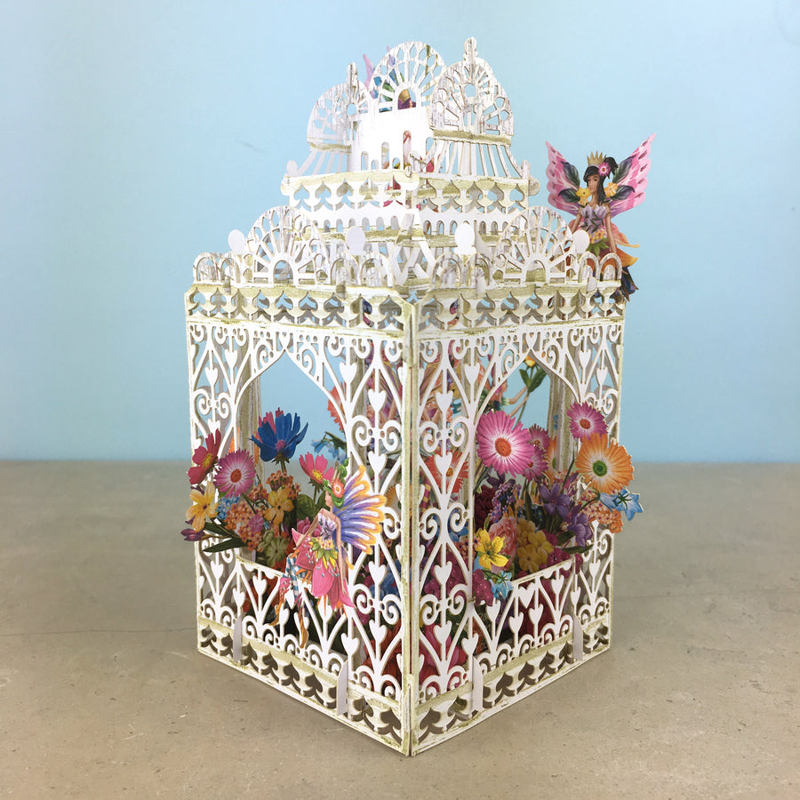 Flower Fairies play amongst flowers in laser cut paper birdcage by Me&McQ