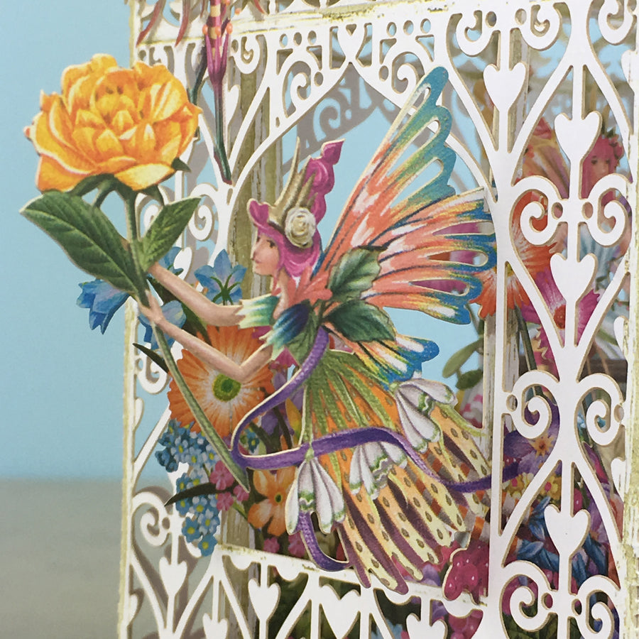 Flower Fairies play amongst flowers in laser cut paper birdcageby Me&McQ