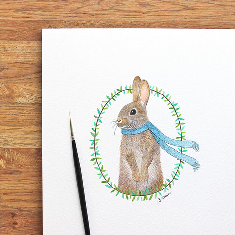 watercolor rabbit illustration with floral design