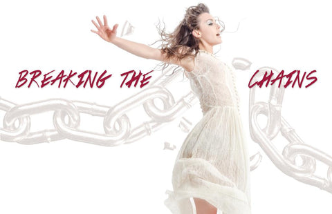 Picture of a girl in a white dress with her arms raised and the words breaking the chains in red