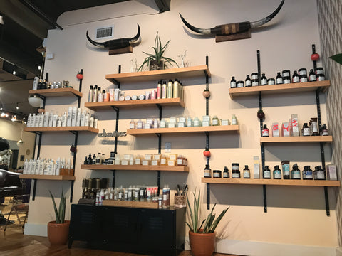 wall of products at Parlor Salon in Richmond, VA
