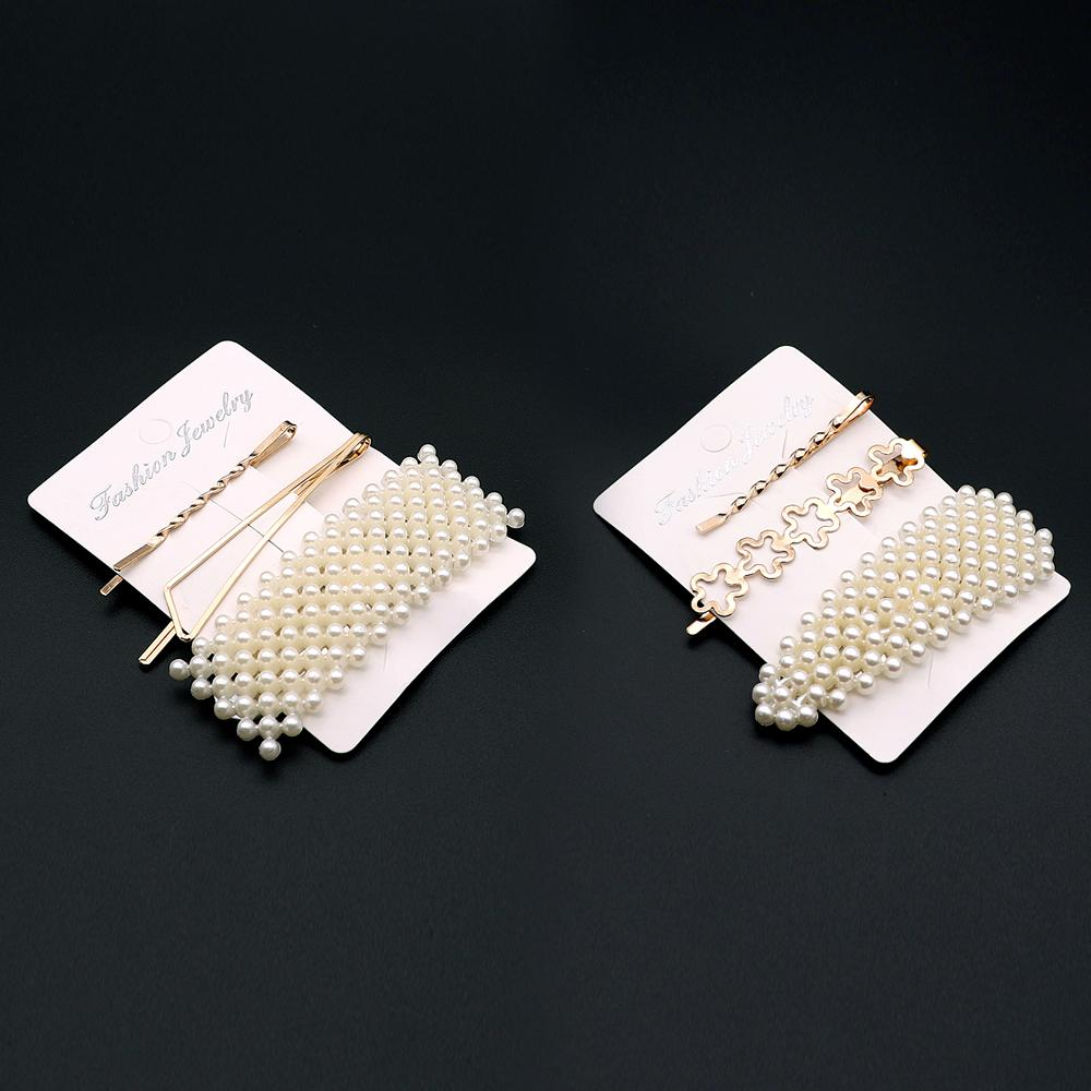 Decent Pearl decorated over sized metal hair pin set