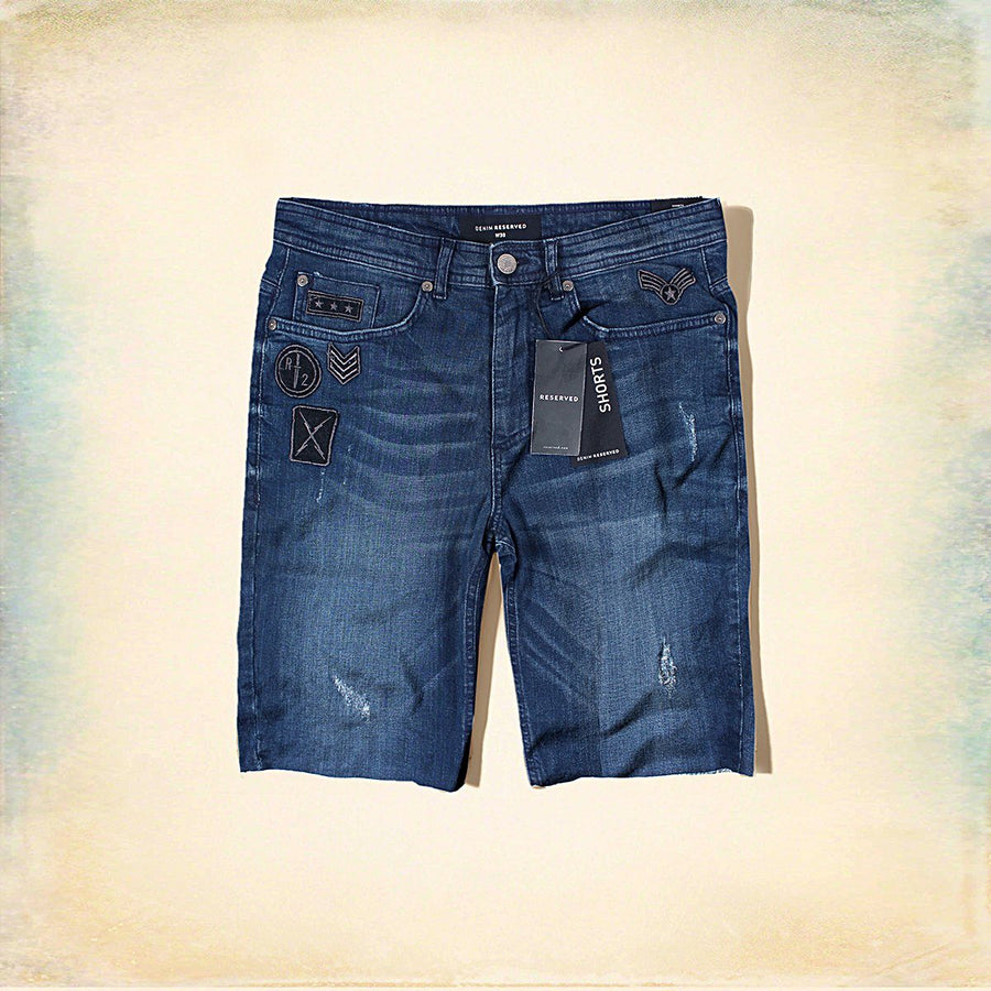 RESERVED-blue denim stretch short with patches