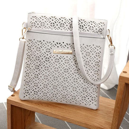 shopify-Blossomita Handbag With Cutout Flower Design-10