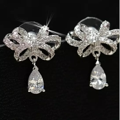 Celebration Earrings Big Bow And Pear Cut Crystal In Silver Polish