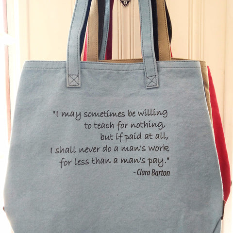 Blue Clara Barton tote bag with quote about equal pay