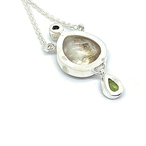 peridot gemstone with pearl pendant