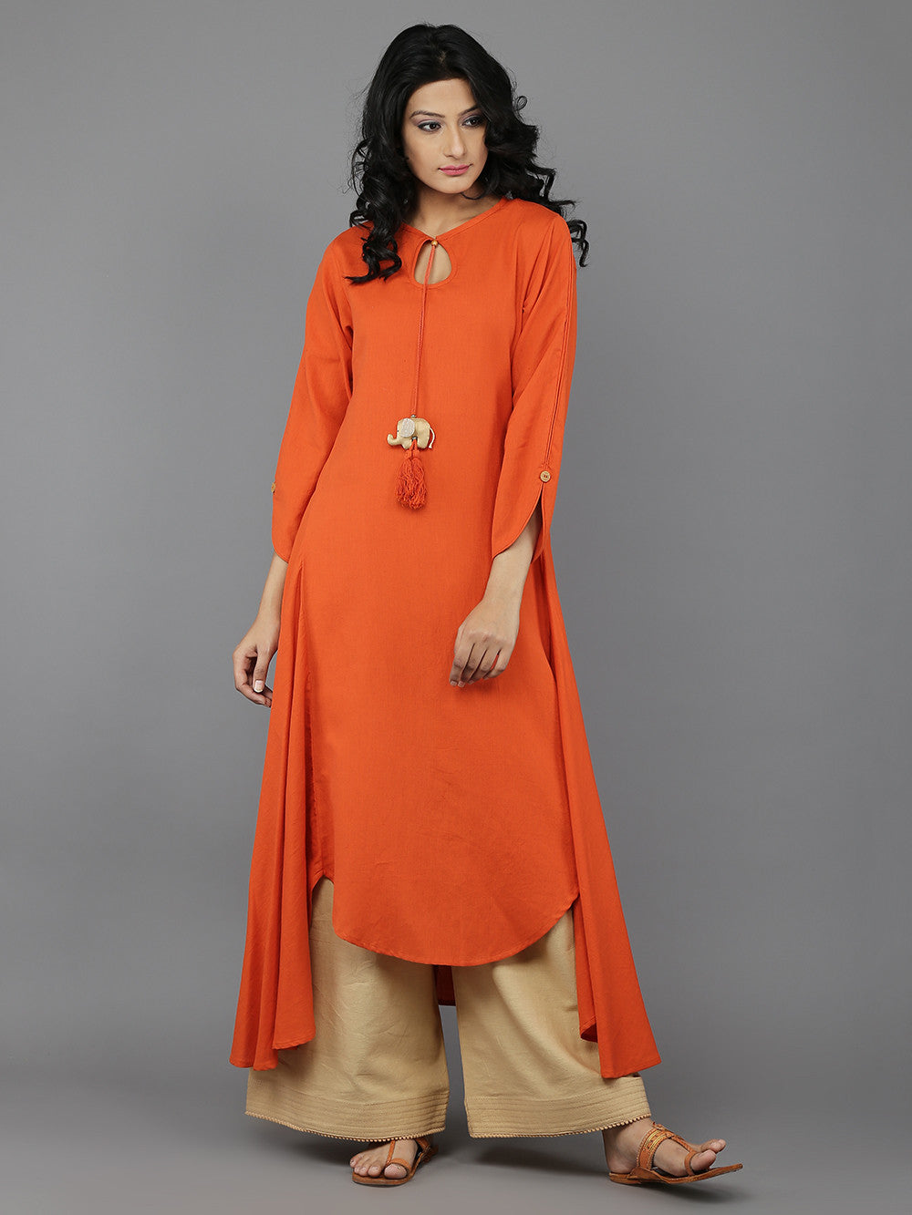 Pastel orange khadi kurta and beige palazzo set from The Loom