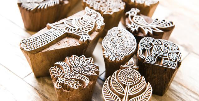 wooden blocks carved with intricate patterns